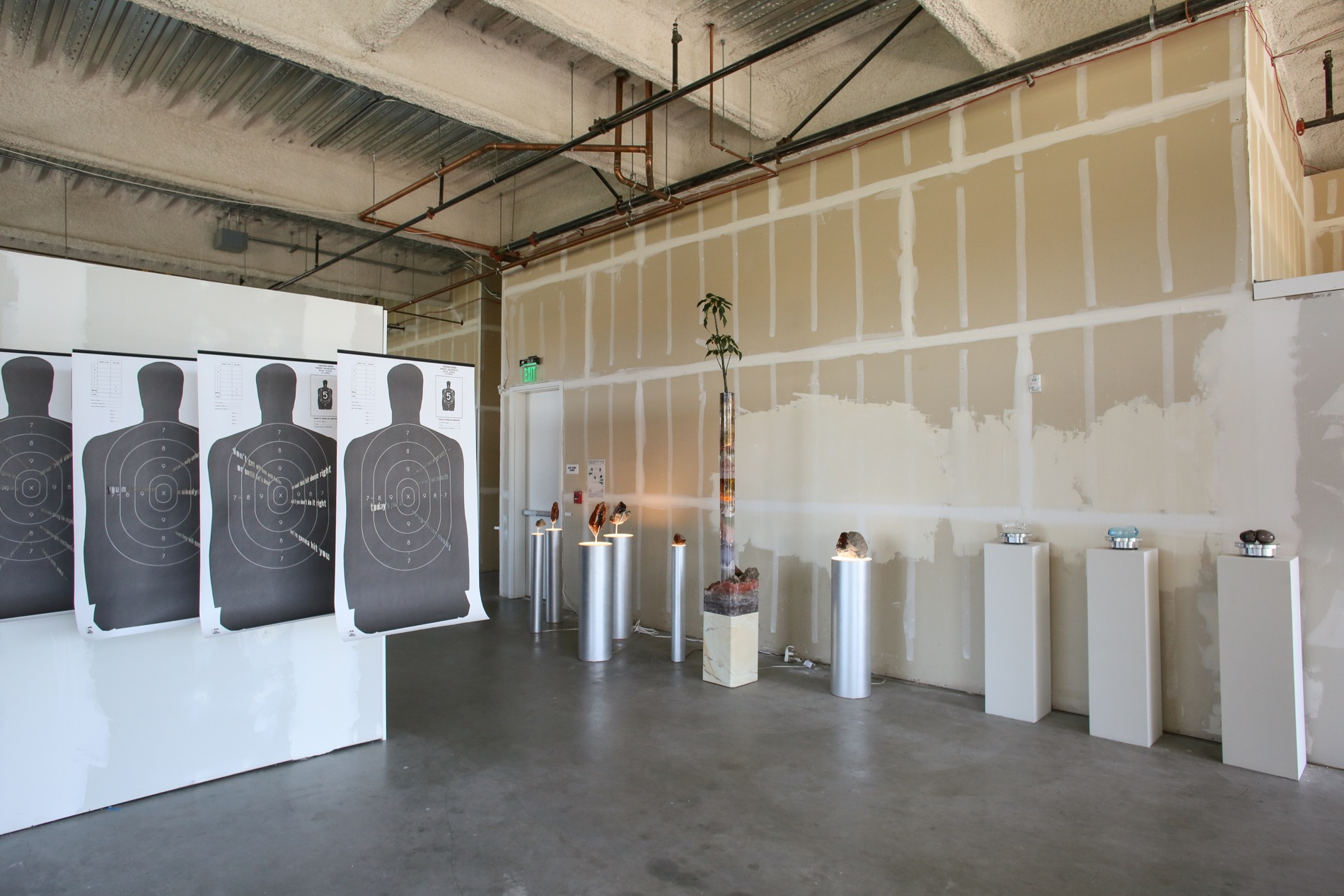 exhibition design was intended to mimic the unfinished look of the existing space, which had been vacant for 10 years